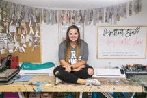 young woman sitting in a craft room