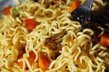 a fork in noodles