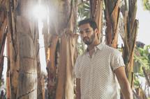 man walking through a tropical jungle