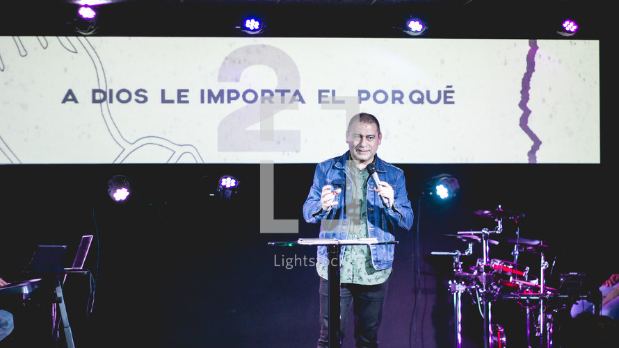 worship leader holding a microphone on stage