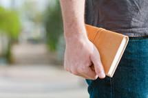 man holding a journal
