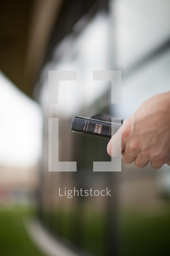 man holding a Holy Bible