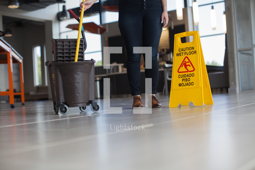a woman mopping a lobby