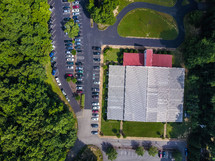 aerial view over a church and parking lot