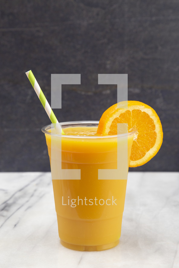 Freshly Squeezed Orange Juice in a Plastic Disposable Cup