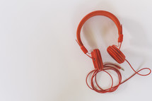 red headphones on a white background