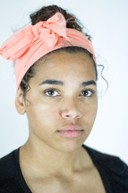 head shot of a young woman with a headband