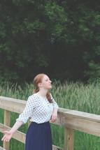 a woman enjoying the fresh air outdoors