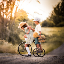 kids on a vintage tricycle