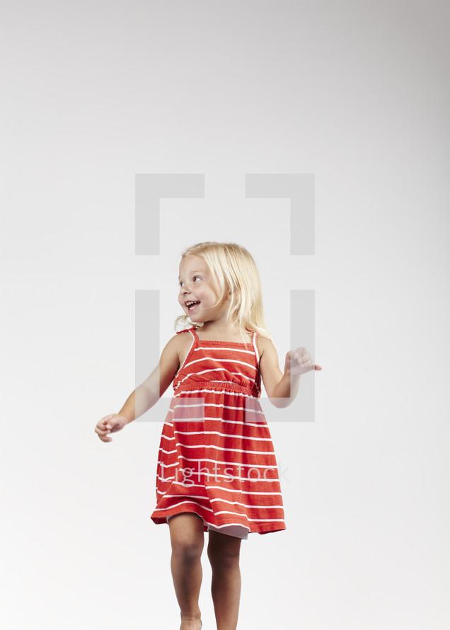 Smiling blonde haired little girl