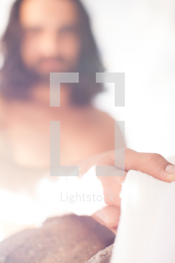 glowing Jesus holding a white shroud