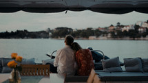 a couple on a dock looking out at the water