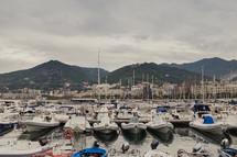 boats docked at a marina in Italy
