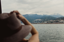 a woman with a hat on a ferry