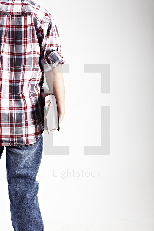 man holding a book with bookmark