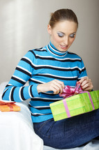 a woman opening a gift