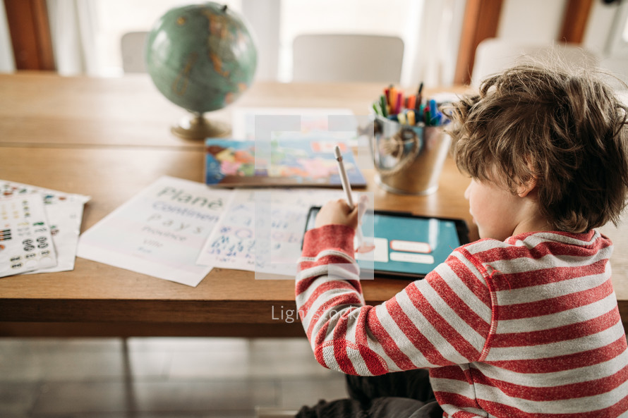 a kid doing school work at home
