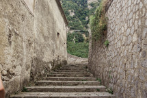 steps through narrow alley in Italy