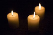 three candles burning