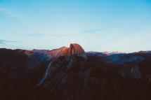 sunlight shining on a mountain peak