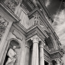 statues and columns on building in Italy