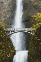 bridge over a ravine and waterfall