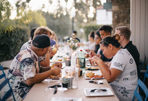 people eating at a dinner party
