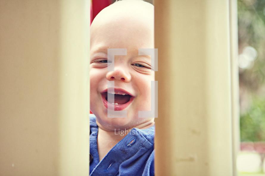 Infant boy smiling
