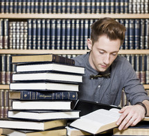 Mr Diligent; man in library reading books.