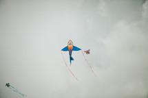 kites flying in the grey sky