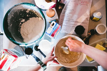 woman making pancake batter in a kitchen
