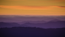 purple mountains majesty and orange sky at sunset