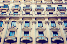 windows on a historic building in Barcelona