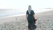a woman walking on a beach