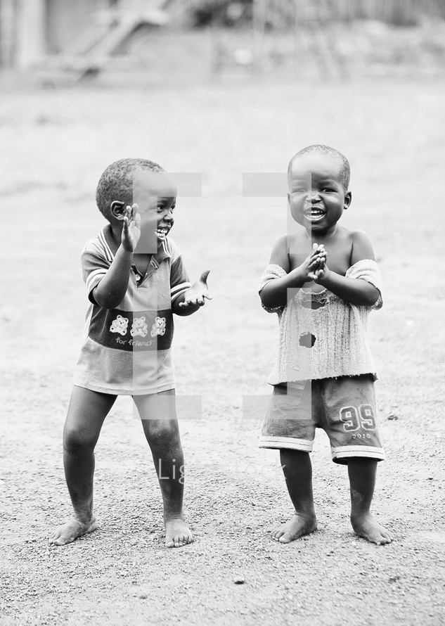 Brothers clapping and laughing