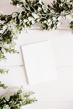 white paper with boxwood border