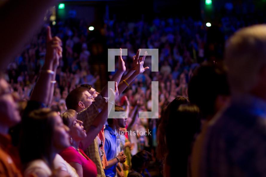 people singing at church