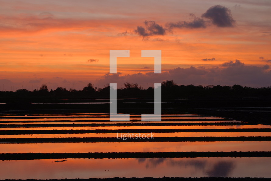 Sunset over a fish farm in Indonesia