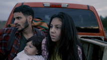 migrant family in the back of a truck