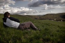 a man lying in a field of grass