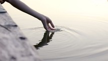 hand touching water
