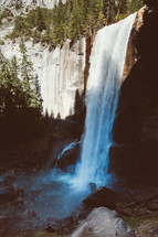 waterfall off the side of a steep cliff