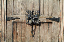 old wooden door with chain lock
