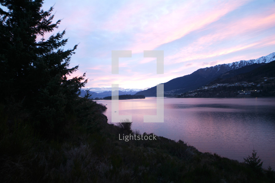 Calm mountainside lake at dawn