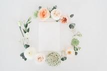 floral wreath around an envelope