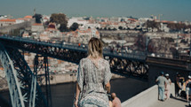 a woman on a bridge taking in the view
