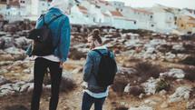 couple walking on a rocky shore