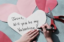 a little girl making Valentine's day card's for Jesus