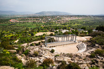 ancient ruins in the holy land and view of modern day suburbs