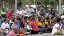 people listening to a worship service in Papua New Guinea